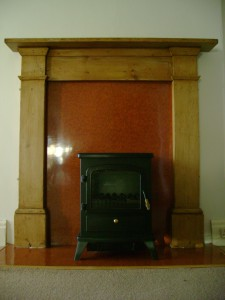 Before- not a stove. This heater has a plug (the least efficient type of heater). The fireplace has been covered with plastic board.