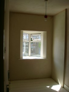 Plastered, with new, deeper, window sill.
